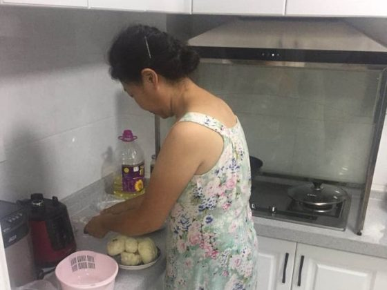 Homestay Mama Cooking Dumplings