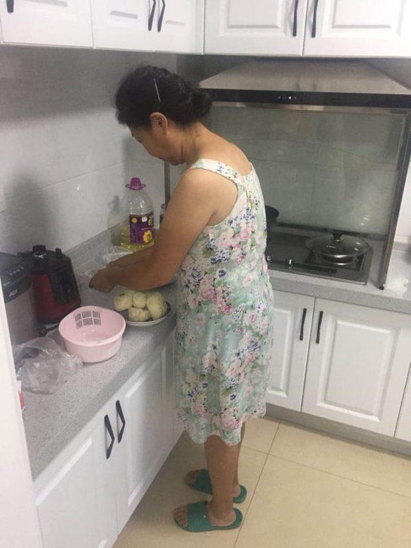 Homestay Mama Cooking Dumplings