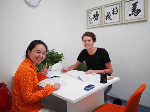 Jamie and teacher inside a classroom.