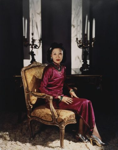 "Madame Koo wearing a ""body-hugging 1930's qipao"" with a side slit"