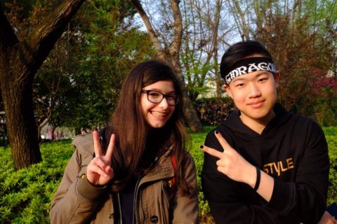Anthea posing with a Chinese friend in a Shanghai park