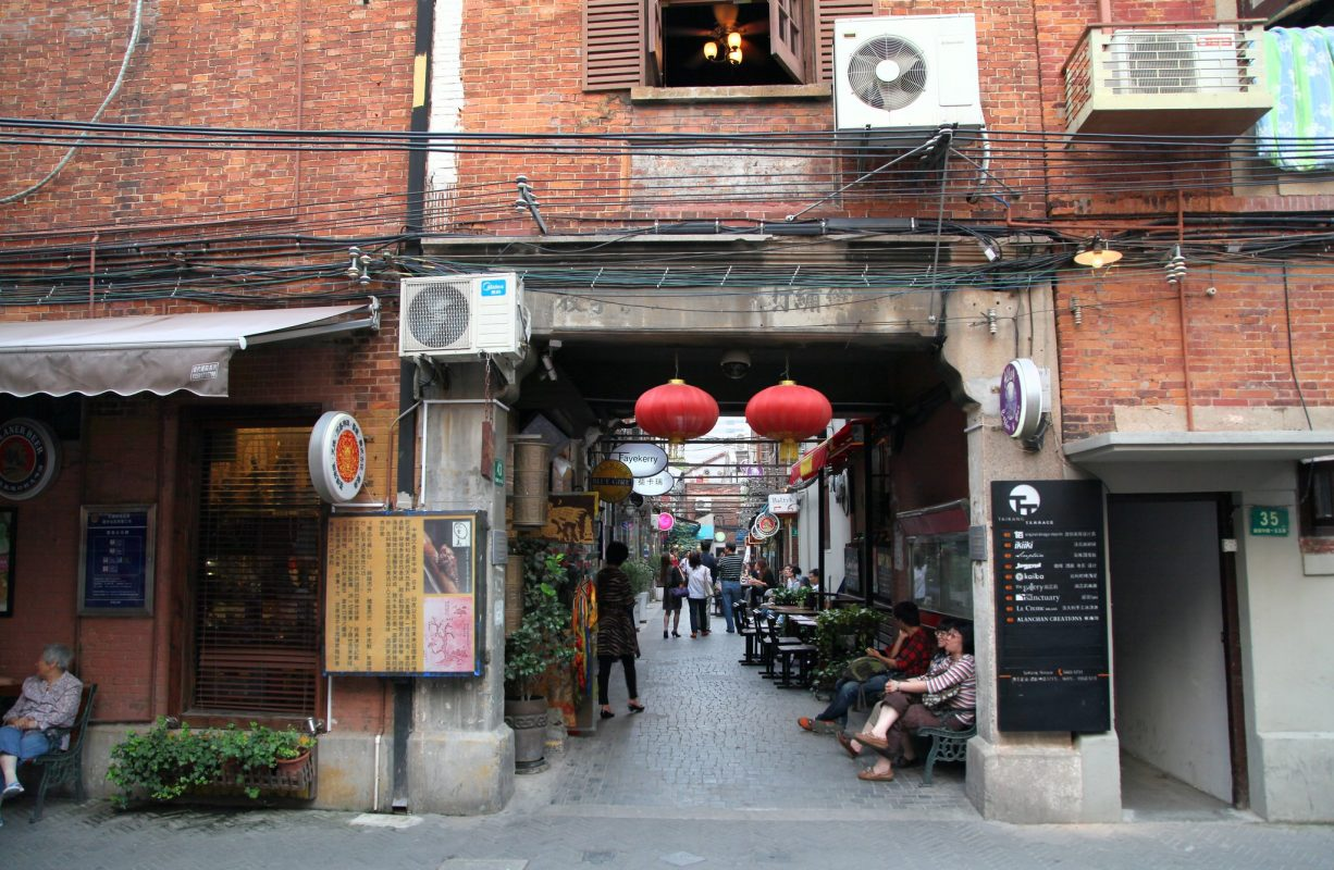"A photo of a shikumen entrance in Tianzifang, taken 2012. ""IMG_6865"" by Mad Ball is licensed under CC BY-SA 2.0."