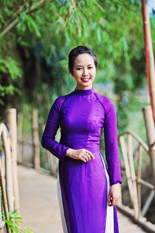 Woman wearing a purple Ao Dai in Vietnam