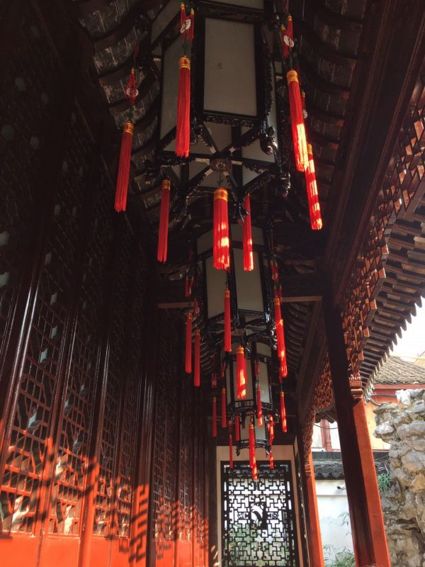 Yu Garden - Lanterns hanging from the roof of one of the buildings in the garden